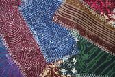 Crazy quilt batik fabric design background — Stock Photo
