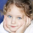 Child with hands cupped on face — Stock Photo #3009240