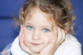 Child with hands cupped on face — Stock Photo
