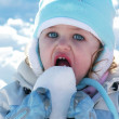 Young toddler eating snow — Stock Photo #3017184