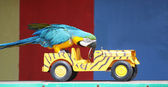 Parrot driving a car — Stock Photo