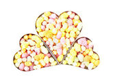 Three hearts filled with candy — Stock Photo