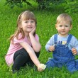 Children sitting in grass — Stock Photo