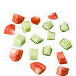 Slices of a cucumber and tomato — Stock Photo