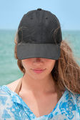 Girl with black baseball cap — Stock Photo