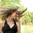 Royalty-Free Stock Photo: Young woman with wind blowing hair