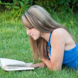 Beautiful girl reads the book — Stock Photo