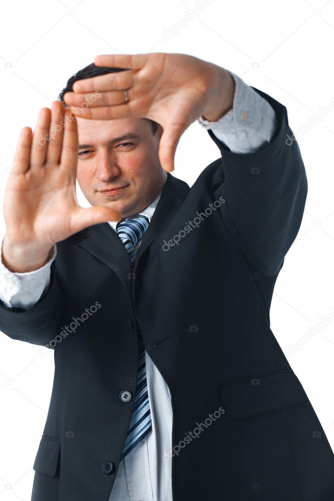 Portrait of a confident young businessman making a frame shape with his hands over white background  — Stock Photo #2945023