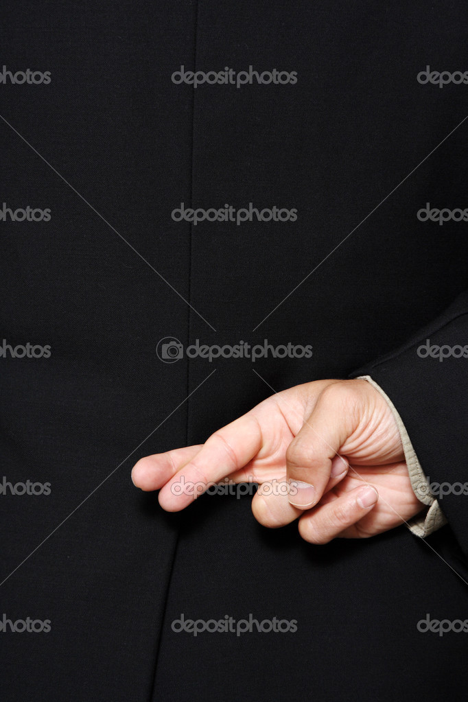 Businessman with his fingers crossed behind his back — Lizenzfreies Foto #3721426