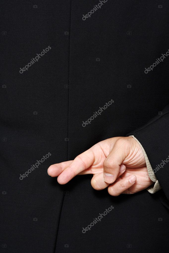 Businessman with his fingers crossed behind his back — Stock fotografie #3721426