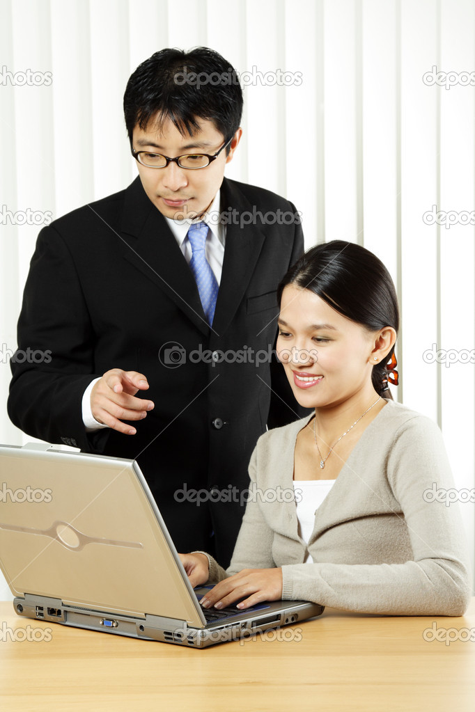 A businessman and a businesswoman working in an office — Stock Photo #3721832