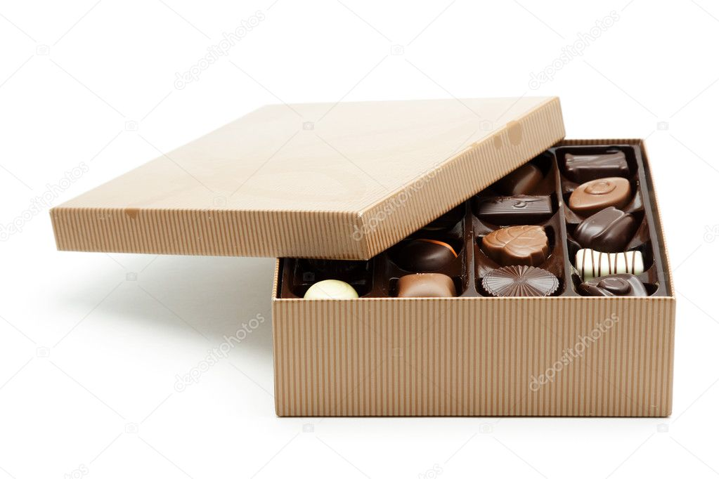 A box of chocolates with the lid opened  Stock Photo #3734564