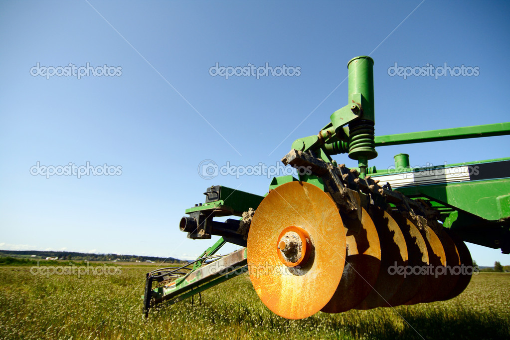A heavy industrial agriculture machinery on an empty field  Stock Photo #3748213