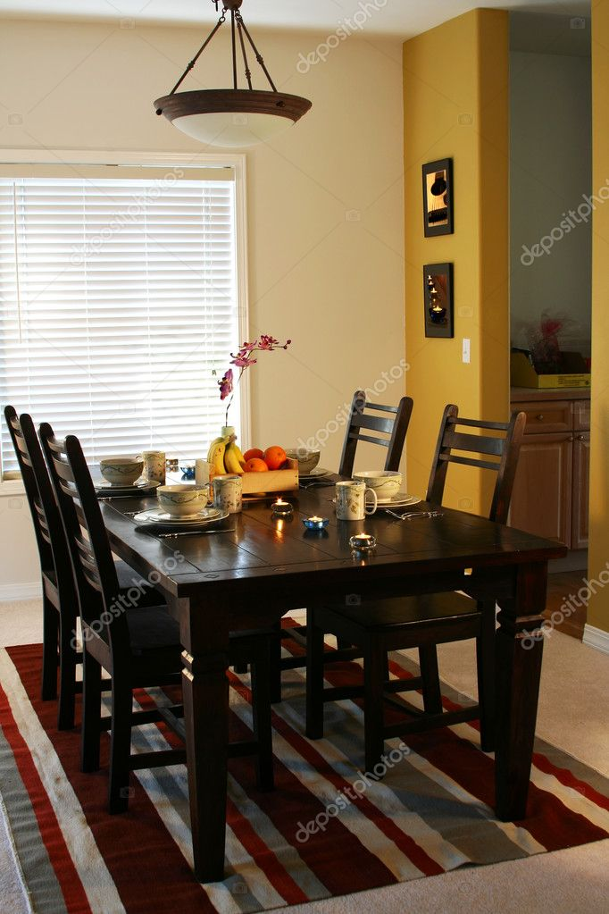 Dining table and plates on a dining table (note: pics on the wall are mine) — Stock Photo #3889465