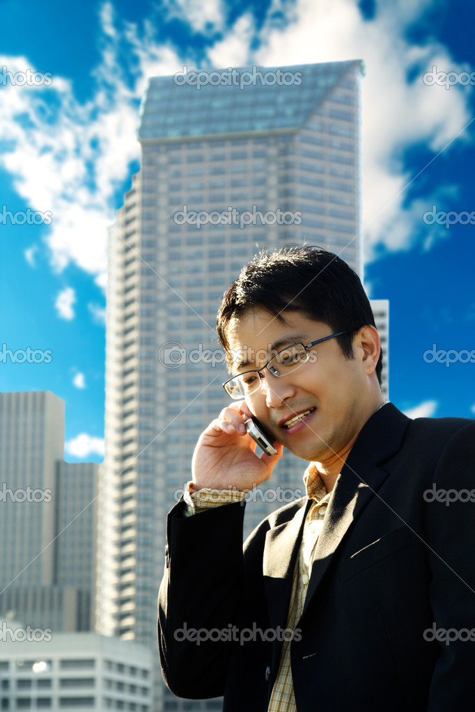 A businessman talking on the phone at a business district — Stock Photo #3889753