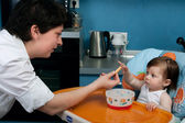 Mother and baby at the kitchen — Stock Photo