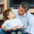 Man and little boy reading book — Stock Photo #2754121