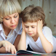Woman and little boy reading book — Stock Photo #2762195
