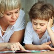 Woman and little boy reading book — Stock Photo