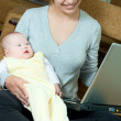 Mother, baby and laptop - Stockfoto