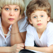 Woman and little boy reading book — Stock Photo #2831691