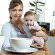 Mother feeding baby — Stock Photo