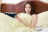 Woman in the bed — Stock Photo