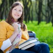 Woman with book in park — Stock fotografie