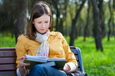 Woman with book in park — Stock Photo