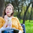 Stock Photo: Woman with book in park