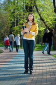Yong woman walking in the park — Stock Photo