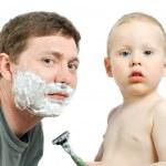 Boy shaving father — Stock Photo