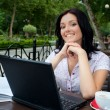 Girl with laptop in cafe — Foto de Stock