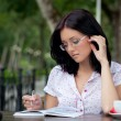 Girl with notepad in cafe — Stock Photo #3857204