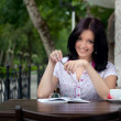 Stock Photo: girl with notepad in cafe