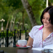 Foto de Stock  : Girl with notepad in cafe