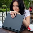Stock Photo: Girl with laptop in cafe