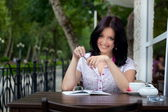 Girl with notepad in cafe — Stock Photo