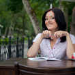 Girl with notepad in cafe — Stock Photo #3900252
