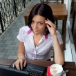 Girl with laptop in cafe — Stock Photo #3900536
