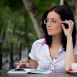 Girl with notepad in cafe — Stock Photo #3900557