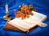 Books, Candle, Flowers And Feather — Stock Photo
