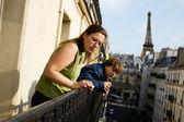 Family on balcony — Stock Photo