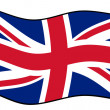 Union Jack flag in wind - Stock Photo