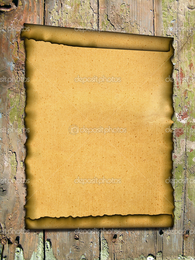 Old paper on an old wooden surface. Grunge background with space for text or image.   Stock Photo #2936396