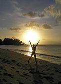 Man on the beach at sunset — Stock Photo