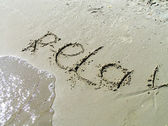 The word the relax is written on sand — Stock Photo