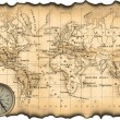 Photo: Ancient map of world. Compass