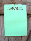 Wanted poster on a wooden wall. — Stock Photo
