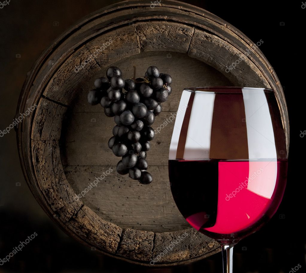 Still life with red wine, glass, cluster and old wood barrel  Stock Photo #2962457